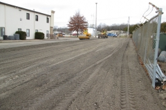 Grading and compacting asphalt in place