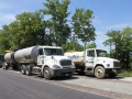 Asphalt Emulsion Tanker & Water Truck hooked up to Recycling Machine (1).JPG