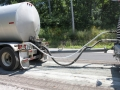 Asphalt Emulsion Tanker & Water Truck hooked up to Recycling Machine (4).JPG