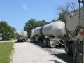 Asphalt Emulsion Tanker & Water Truck hooked up to Recycling Machine (5).JPG